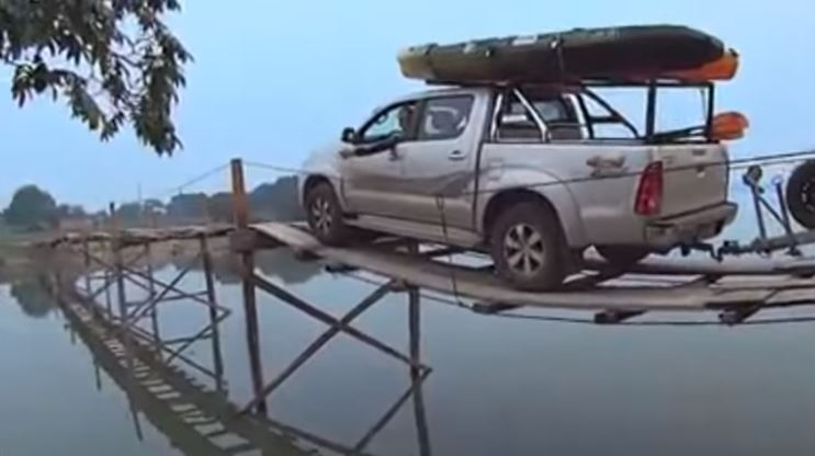 Nerve Wracking Trip Of A Truck Over Water on a Tiny Wooden Bridge