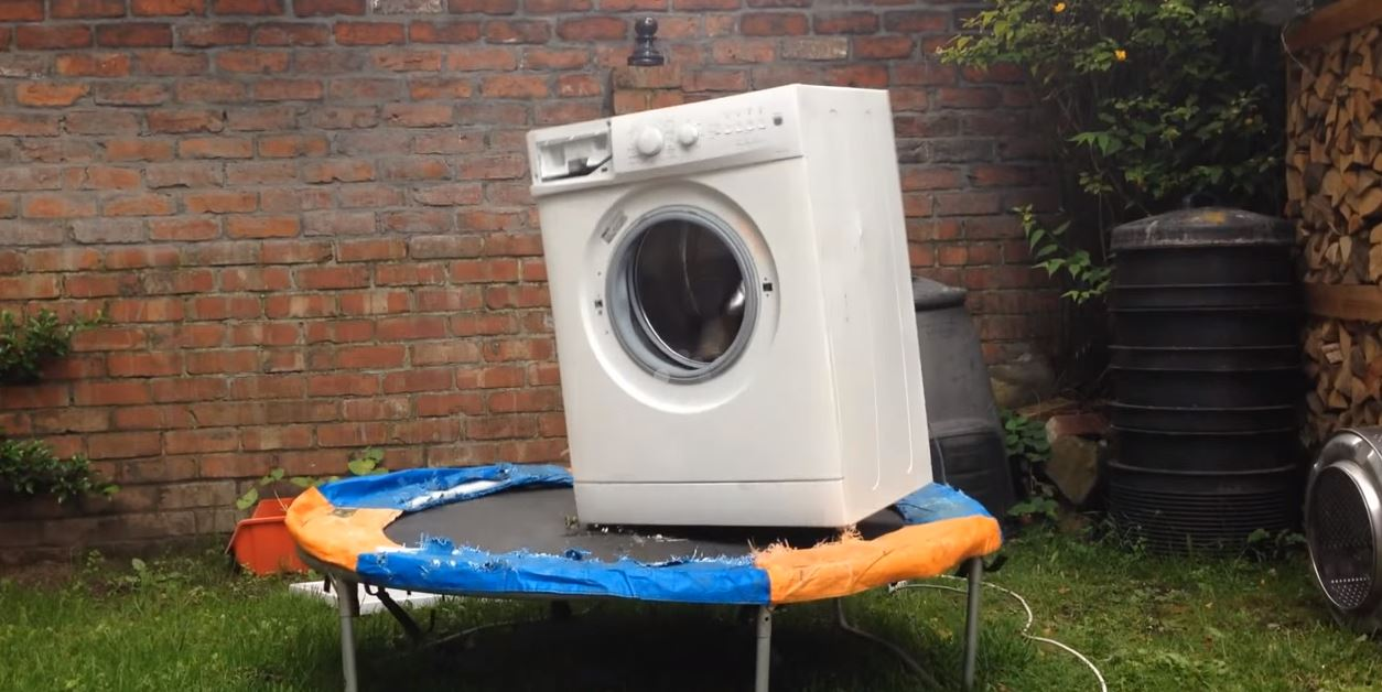 Brick Inside a Washing Machine and It's On a Trampoline