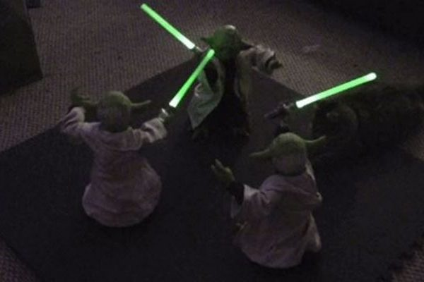 Three Animatronic Yoda Toys Have an Awkward Lightsaber Battle