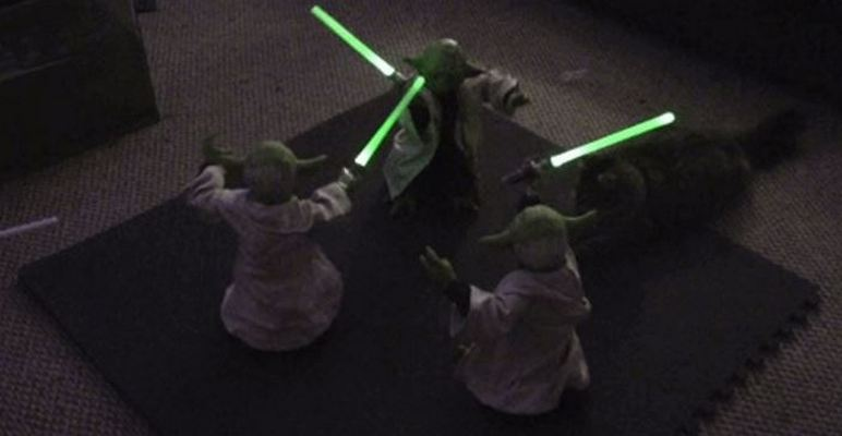 Three Animatronic Yoda Toys Have an Awkward Lightsaber Battle