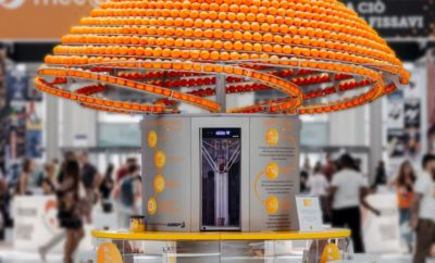 A Giant Circular Juice Machine That Turns Discarded Peels of Squeezed Oranges Into 3D Printed Juice Cups